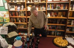 Steve Carter, of Glen Ellyn, explains the taste of the different wine samples on Nov. 2, during the annual Fall Wine Walk and Shop event at Centuries and Sleuth's on Madison Street in downtown Forest Park, Ill. | ALEX ROGALS/Staff Photographer