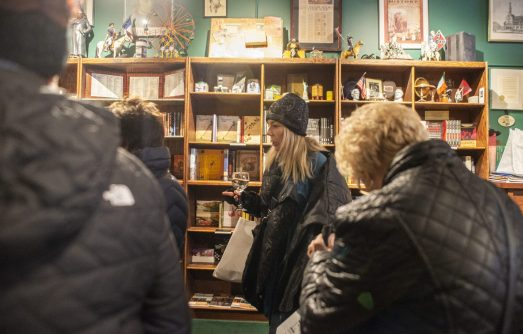 Participants wait in line to sample different wines on Nov. 2, during the annual Fall Wine Walk and Shop event at varies local shops on Madison Street in downtown Forest Park, Ill. | ALEX ROGALS/Staff Photographer