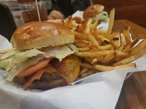 The Elmwood Park Burger is the most popular menu item at Burger Moovment. It features applewood smoked bacon and Moov sauce to give it a special kick. | MELISSA ELSMO/Contributor