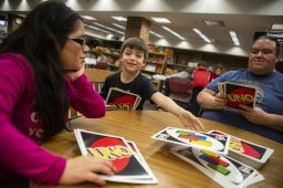 Mya S., Alex S. and George S. play UNO together on March 16 during the S.T.E.A.M. Fair at the public library. | Alex Rogals/Staff Photographer