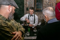 O'Sullivan's manager Anthony Crawford mixes drinks for Jason Maxham (left) and Ned Wagner at the Historical Society's Volstead Act fundraiser on Jan. 17. | Photo by Alexis Ellers