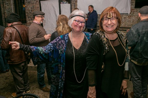 Carol Stewart Gulyas (left) and Chris Everett enjoy the Forest Park Historical Society's prohibition party and fundraiser at O'Sullivan's, 7244 Madison St. on Jan. 17. | Photo by Alexis Ellers