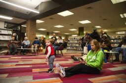 Attendees listen to Kettlestrings perform on Saturday, Feb. 8, 2020, during the re-opening party at the Forest Park Public Library on Des Plaines Avenue in Forest Park, Ill.   ALEX ROGALS/Staff Photographer