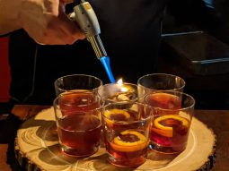 Ed Pogue fires wood to infuse whiskey and bourbon with smoke.