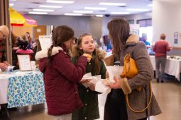 Forest Park residents left to right, Viviana Perez, 10, Ava Vavken, 9, and Shilin Horar enjoying hot dogs and each other's company during Forest Park's Leap Day History & Community Festival. | SHANEL ROMAIN/Contributor