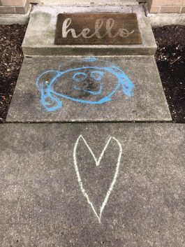 Forest Park residents are participating in a window art and sidewalk chalk projects to stay connected safely.