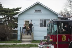 Residents stood outside their homes on April 12 to watch the Easter bunny ride past on a Forest Park fire truck. | Alex Rogal, Staff Photographer