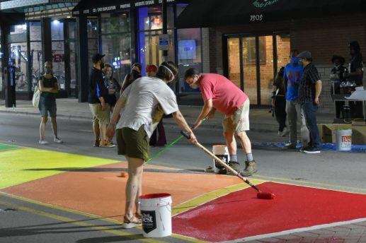 Artists painted rainbow colors on the median in front of Urban Pioneer Group from midnight until 2 a.m. on July 1. | Photo by Jill Wagner