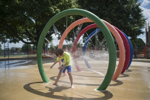 Max Bozman of Forest Park enjoys the park district's spray ground, which recently reopened to residents. | Alex Rogals, Staff Photographer