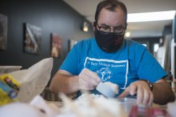 Technical director Jeremiah Barr of The Actors Garden packs materials for mask making. | Alex Rogals, Staff Photographer