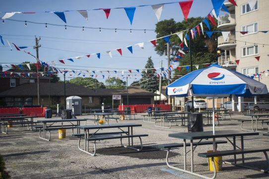 Outdoor dining tables are seen set up on North Avenue on Saturday, July 25, 2020 for Elmwood Park outdoor eating. Photo by ALEX ROGALS/Staff Photographer.