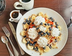 Yia Yia's waffles feature imported Greek yogurt, fresh berries, bananas and local honey.