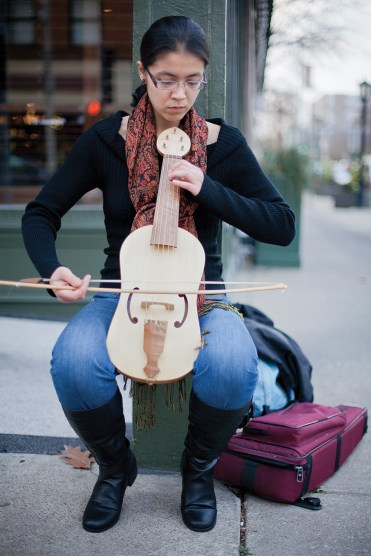 Laura Osterlund with her vielle, a medieval fiddle, on Oak Park Avenue and Lake Street.DAVID PIERINI/Staff Photographer