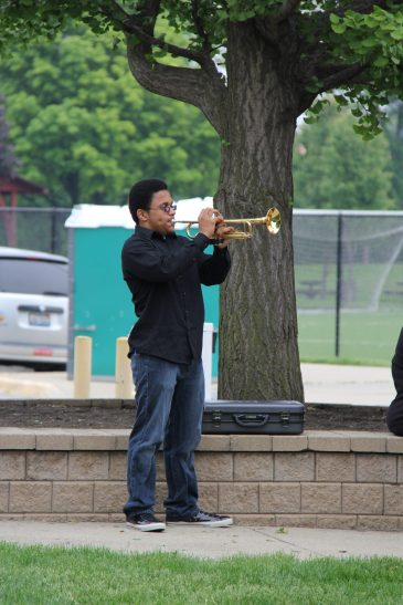 A bugler plays Taps at Forest Park's Memorial Day commemoration. Courtesy Rachell Entler, Park District of Forest Park.