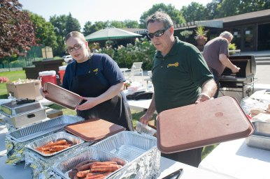 Paul McKenna, long-time owner of Starship Subs (right) has reinvented his business to include catering, like this recent picnic at the River Forest Tennis Club.
