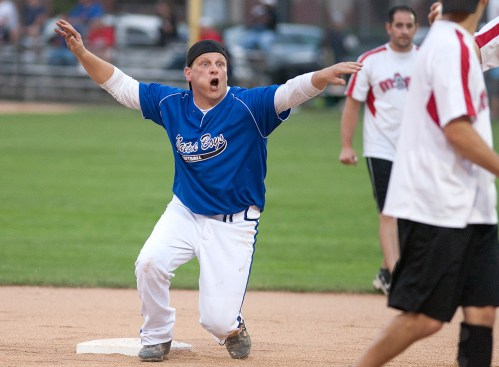 Jimmy Grasz of the Nature Boys tries to correct an umpire after he was called out at second during the opening games of the No Gloves Nationals in Forest Park. Play continues through Sunday at The Park. (David Pierini/staff photographer)