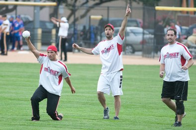 Monkey Softball right fielder George Beres shows the ump that he made a fare catch against the Nature Boys. (David Pierini/staff photographer)