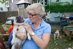 Deb Dworman, owner of deedee & edee boutique in Forest Park, hosts the pug party each Saturday morning.