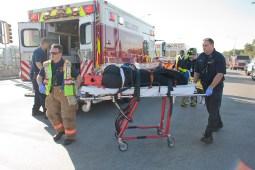 A woman complaining of pain is wheeled toward an ambulance on Harlem Avenue. (David Pierini/staff photographer)