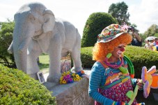 A clown pauses after placing flowers at Showmen's Rest monument during a memorial ceremony at Woodlawn Cemetery in Forest Park for circus artists who died in a 1918 train accident.