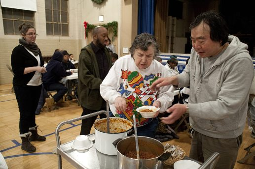 Volunteer Betty Dvorak, center, served bowls of chilli to homeless men and women at the PADS shelter in St. John Lutheran Church in Forest Park Friday. (David Pierini/staff photographer)