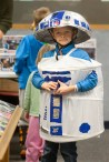 Carter Hartsock, 6, of Forest Park, attended the Forest Park Public Library Mini Comicon Saturday in droid style. A collapsable laundry hamper and paper machete hat transformed into R2D2 of Star Wars fame. (David Pierini/staff photographer)