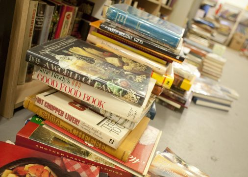 Treasure trove: Looking Glass Books in Oak Park recently acquired thousands of cook books from the estate of a woman who formerly owned an antiques store in Forest Park. Many books are in boxes and on the floor because there is not enough shelf space for them. (David Pierini/Staff Photographer)