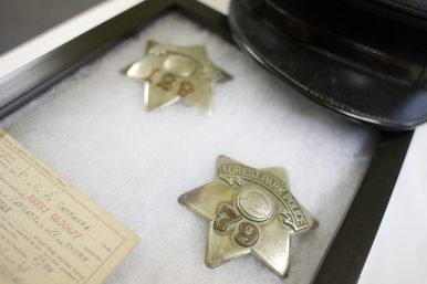 A pair of vintage Forest Park police badges on display at the new home of the Historical Society of Forest Park. (DAVID PIERINI/Staff Photographer)