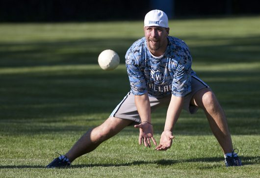 Wallace Softball's Randy Zeis keeps his eye on a ball hit to him. (David Pierini/staff photographer)