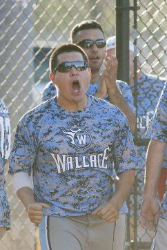 The Wallace Softball dugout roars after an RBI hit. (David Pierini/staff photographer)