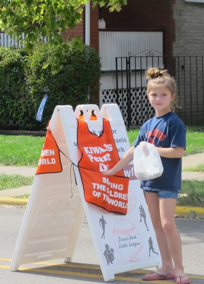 Storey Novak helps collect donations for Forest Park Little League Sept. 27. (JEAN LOTUS/Staff)