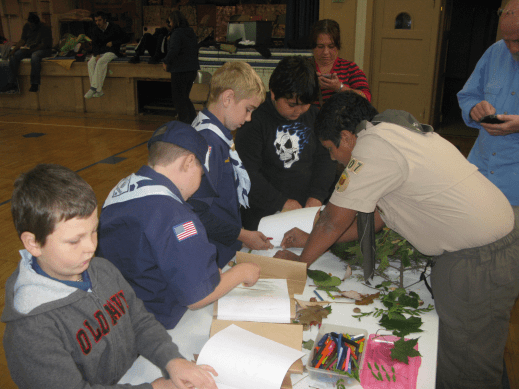 Boy Scout Vishnu Nair leads the Bear Scouts on tree identification and leaf rubbing at St. John Church. (Courtesy Jill Wagner)
