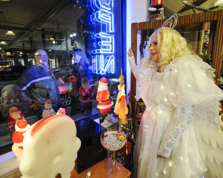 Lynnette Abrams (on right), of Glendale Heights, is the Christmas at the Madison Antiques Mall along Madison Street during the Holiday Walk on Friday, December 5, 2014. (Jennifer Wolfe/Contributor)