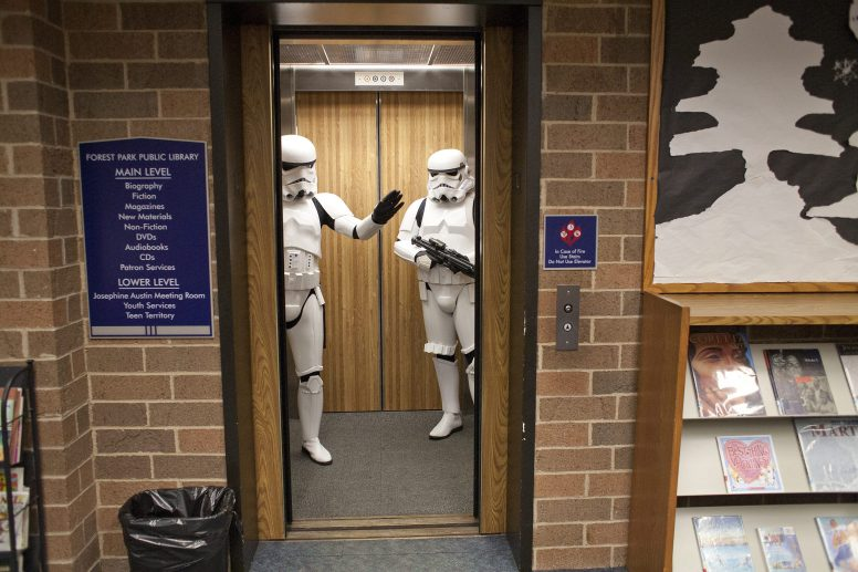 A pair of storm troupers make a friendly exit from the main floor of the Forest Park Public Library during Mini Comicon in January, 2014. (File photo)