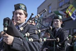 A group of bagpipers prepared to march and blow. (CHANDLER WEST/Staff Photographer)