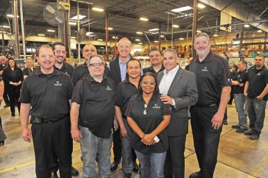 Governor Bruce Rauner (center, back row) works to offset his anti-union reputation during a visit to Essentra on Industrial Drive in Forest Park. Also visiting was Hugo Chaviano (second from right above), director of the Illinois Dept. of Labor. | Courtesy Essentra