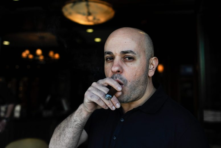 Mike Khalil, owner of the cigar shop Casa de Purros, wants to make it a premier spot in the Forest Park downtown area. | William Camargo/Staff Photographer