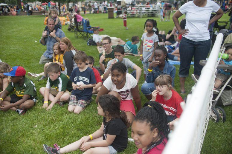 Children watch a Forest Park police K-9 demonstration. | William Camargo/Staff Photographer