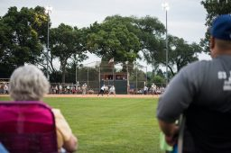 Spectators in the outfield take in a great view of the game just past the home run line. | MAX HERMAN/Contributor