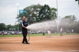 Larry Buckley, superintendent of parks, waters down the field between games. | MAX HERMAN/Contributor