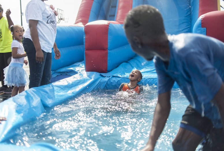 Jeremiah Banks enjoys the water slide during the Back 2 School Celebration. | William Camargo/Staff Photographer