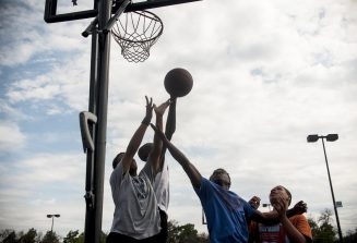 Teams play a game of basketball. | William Camargo/Staff Photographer