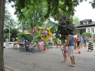 The 600 block of Beloit block party featured a birthday pi?ata. | JACKIE SCHULZ/Contributor