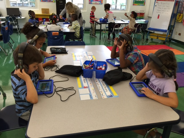 Ms. Ford's Kindergarten students using their tablets for learning.