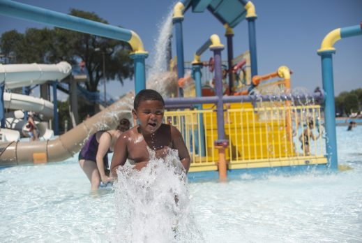 Isaia Gibson plays in a fountain. | William Camargo/Staff Photographer