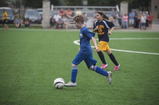 Tom Schmiedeler drives the ball down the field. | William Camargo/Staff Photographer