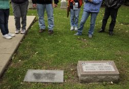 Tour participants pay respects and listen to the stories of various labor figures buried in the cemetery. | William Camargo/Staff Photographer