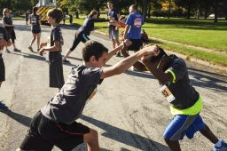 Henry Detmer (left), and Michael Preston (right) stretch before the kids' race.   William Camargo/Staff Photographer