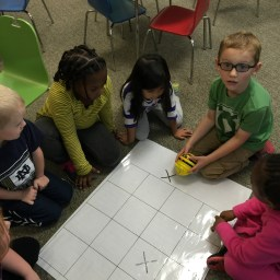 Mrs. Farrington's Kindergarten students working with the BeeBots.