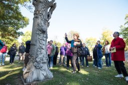 Guide Jan Dressel talks about the cemetery's picturesque monuments and their high cost. | MAX HERMAN/Contributor